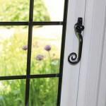 Monkey tail handle leaded windows