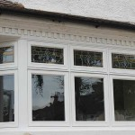 Timber stained casement windows