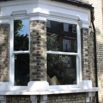 UPVC sash window frame with traditional timber finish